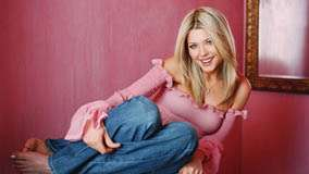 Tara Reid Smiling Naughty Sitting Pose In Pink Top N Blue Jeans