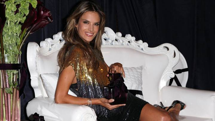 Alessandra Ambrosio Smiling Sitting Pose In Black N Golden Shining Dress