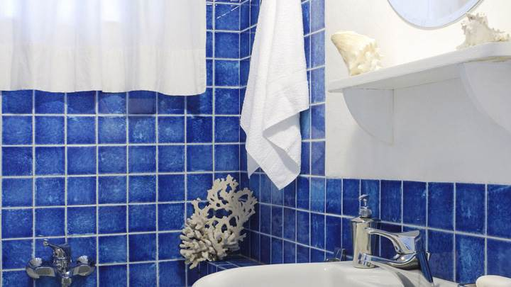 Blue Interior in Bathroom And White Sink Closeup