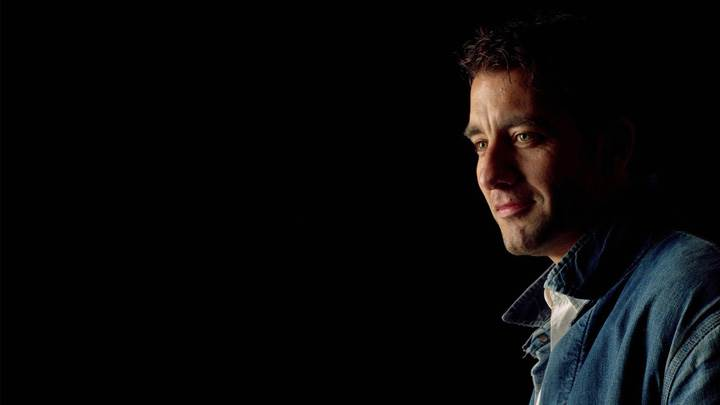 Clive Owen Smiling Side Pose N Black Background