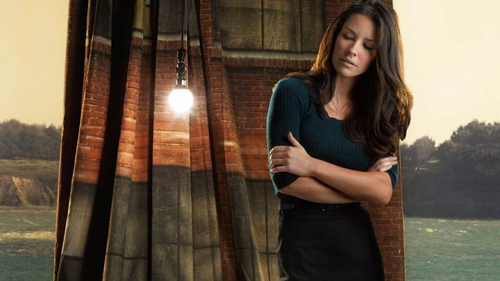 Evangeline Lilly Looking Down In Black Dress Photoshoot
