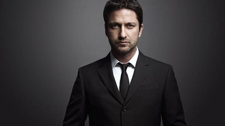 Gerard Butler Looking Front At Camera In Black Coat Photoshoot