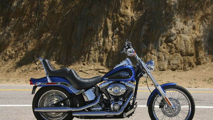 Harley Davidson Softail Custom Fxstc Side Pic Near Mountains