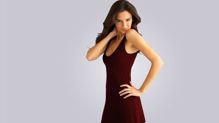 Jennifer Lamiraqui Smiling Modeling Pose In Brown Dress