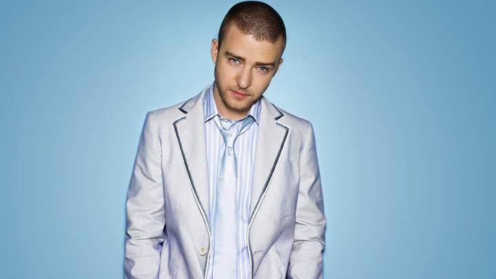 Justin Timberlake Blue Eyes Looking At Camera In Coat N Blue Background