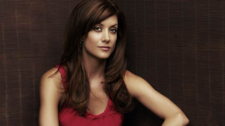 Kate Walsh Looking Front In Red Top Photoshoot Wallpaper