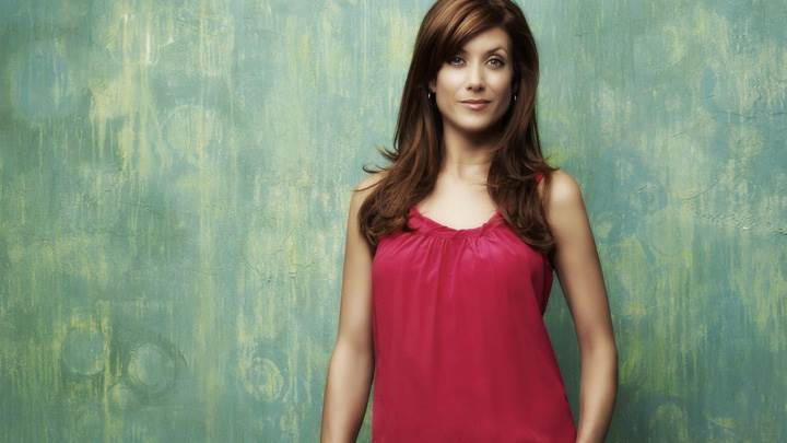 Kate Walsh Smiling In Red Top Modeling Pose