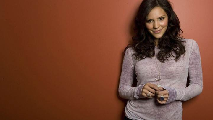 Katharine McPhee Smiling In Top N Jeans N Brown Background