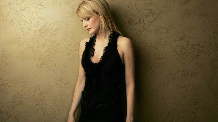 Kathryn Morris Looking Down In Black Dress Side Pose