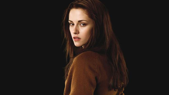 Kristen Stewart Looking Back In Brown Woolen Top N Black Background