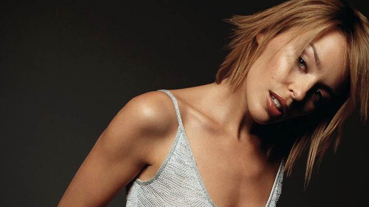 Kylie Minogue Hot Looking In Grey Top Photoshoot N Black Background