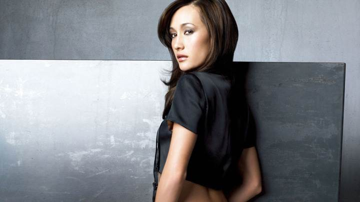 Maggie Q Looking Back In Black Top Side Pose Photoshoot