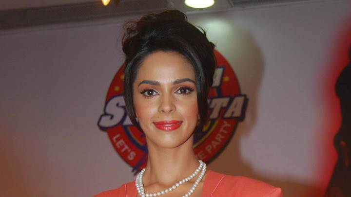 Mallika Sherawat Looking At Camera In Red Lips Photoshoot
