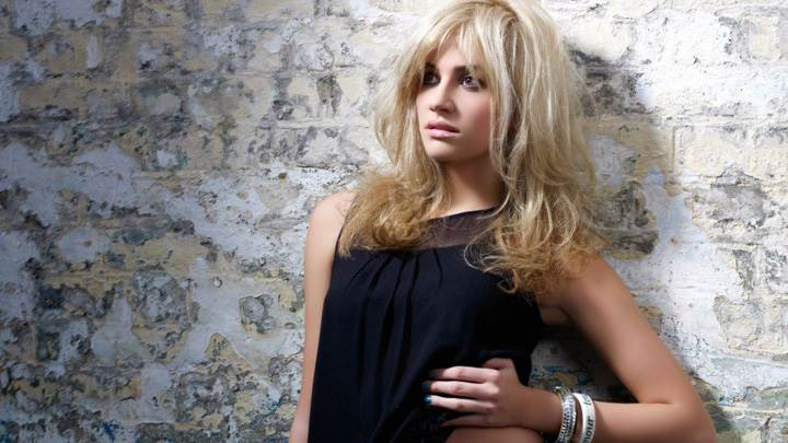 Pixie Lott In Black Dress Standing With Wall Photoshoot