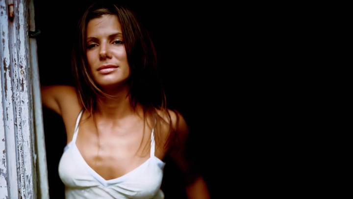 Sandra Bullock In White Top Looking Outside Door