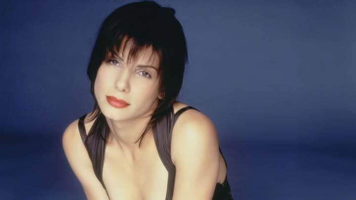 Sandra Bullock Red Lips Sitting Pose In Black Dress N Blue Background