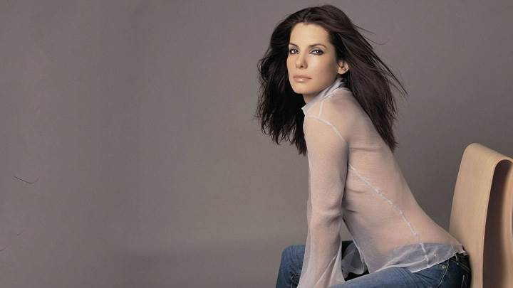 Sandra Bullock Sitting Pose In Transparent Top N Blue Jeans Side Pose