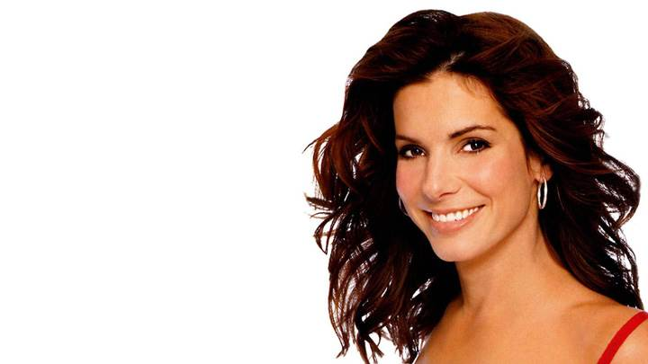 Sandra Bullock Smiling Side Pose N White Background