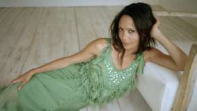 Thandie Newton Smiling Laying Pose In Green Dress