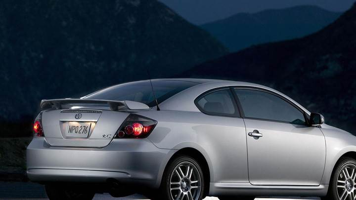 2009 Scion TC In Silver Near Mountains Pose In Night