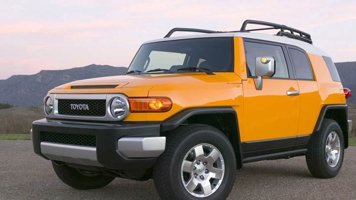 2009 Toyota FJ Cruiser In Yellow Near Mountains