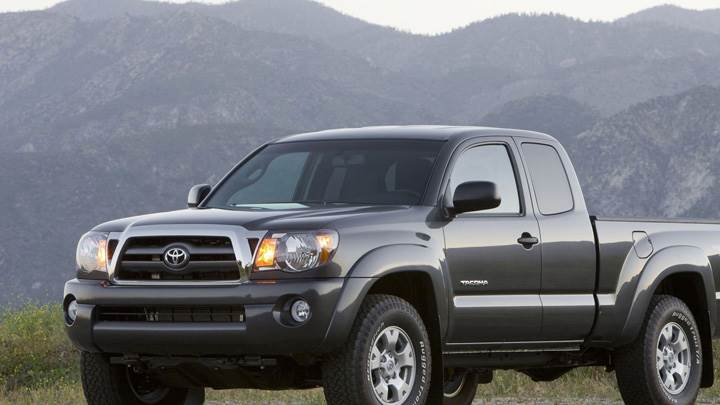2009 Toyota Tacoma In Dark Grey Near Mountains