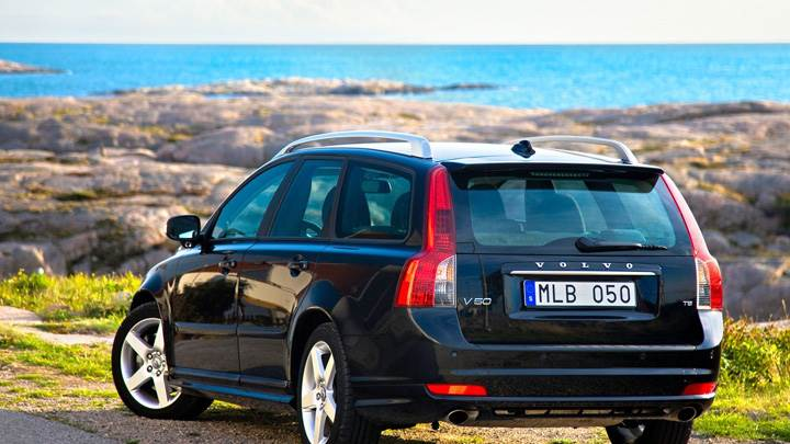 2010 Volvo V50 Near Sea In Black Back Pose
