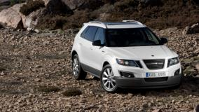 2011 Saab 9-4X In White Front Pose Near Stones