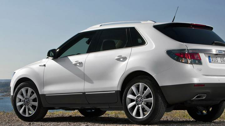 2011 Saab 9-4X Side Pose In White Near River