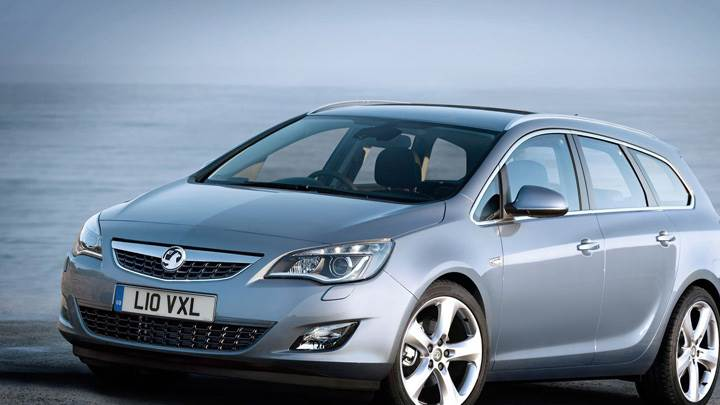 2011 Vauxhall Astra Sports Tourer Front Side Pose Near Sea Wallpaper