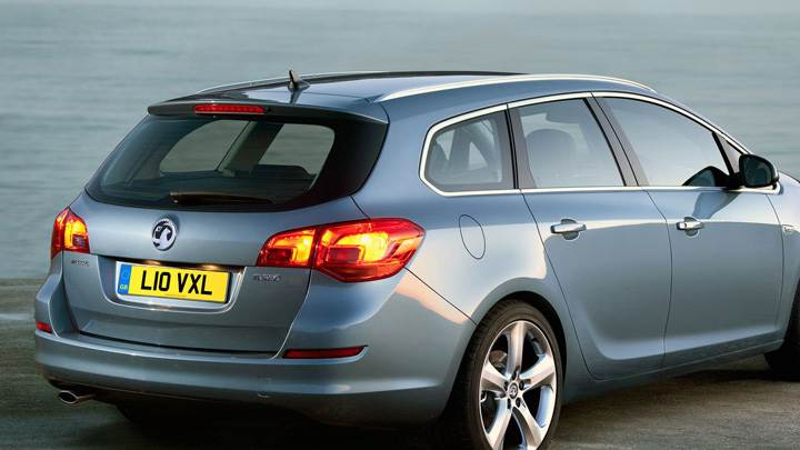 2011 Vauxhall Astra Sports Tourer In Blue Back Pose Near Sea