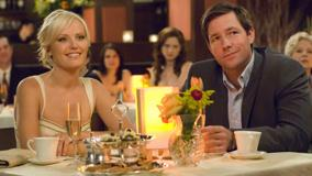 27 Dresses – Malin Akerman And Edward Burns Smiling Sitting Pose