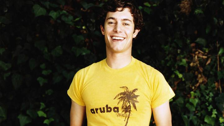 Adam Brody Laughing In Yellow T-Shirt