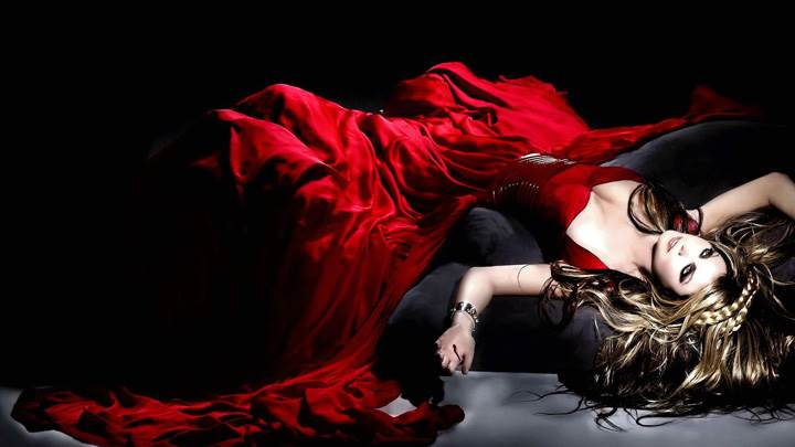 Beautiful Pose Of Sarah Brightman Laying In Long Red Dress