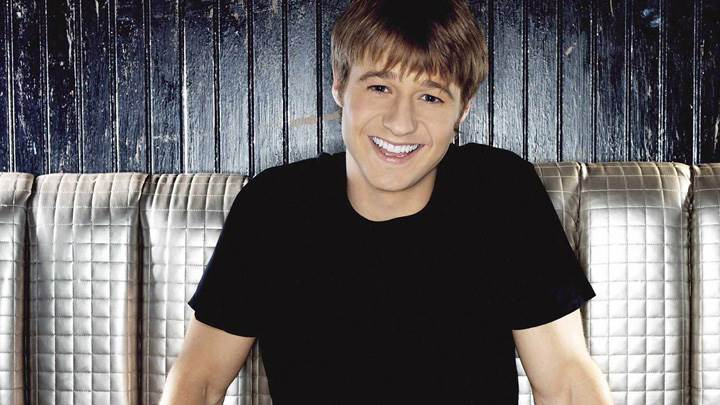 Benjamin Mckenzie Cute Smiling In Black T-Shirt Sitting Pose