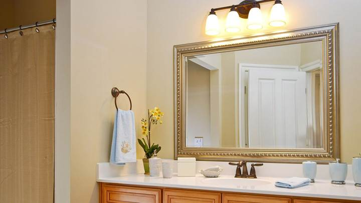 Big Mirror With Golden Frame In Bathroom