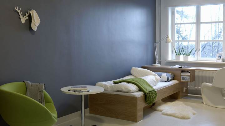 Blue Background And Wooden Bed In Room