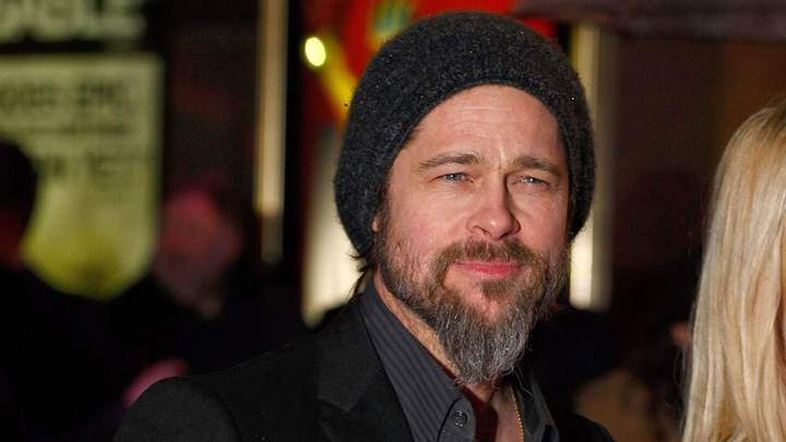 Brad Pitt Smiling N Wearing Black Woolen Cap Photoshoot