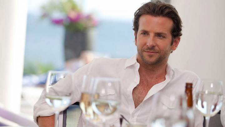 Bradley Cooper Sitting On Dining Table In White Shirt