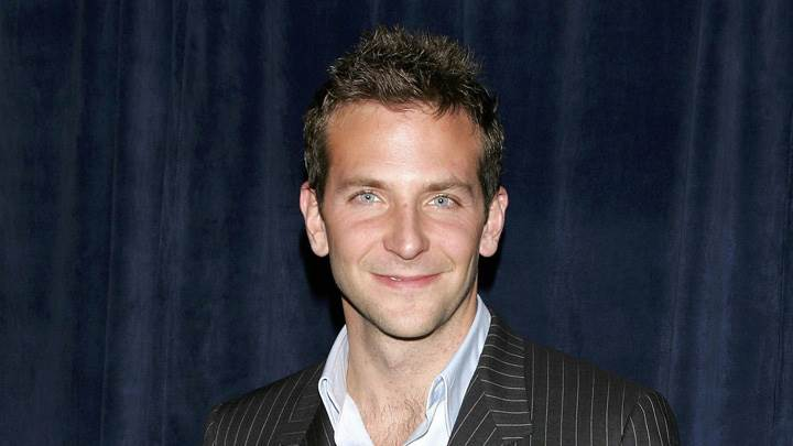 Bradley Cooper Smiling In Black Coat N Blue Background