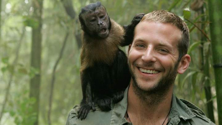 Bradley Cooper Smiling With Monkey On Shoulder In Forest