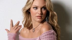 Candice Swanepoel In Purple Woolen Top Sitting Pose