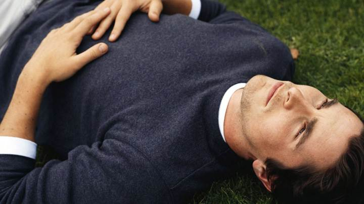 Christian Bale In Black T-Shirt Laying Pose On Grass