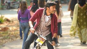 Dhanush Looking Side On Bycycle Outside The College In Kutty Movie