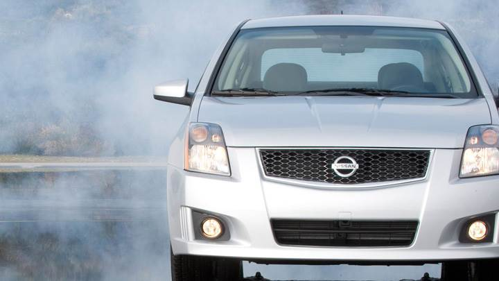 Front Pose Of 2009 Nissan Sentra SR In White