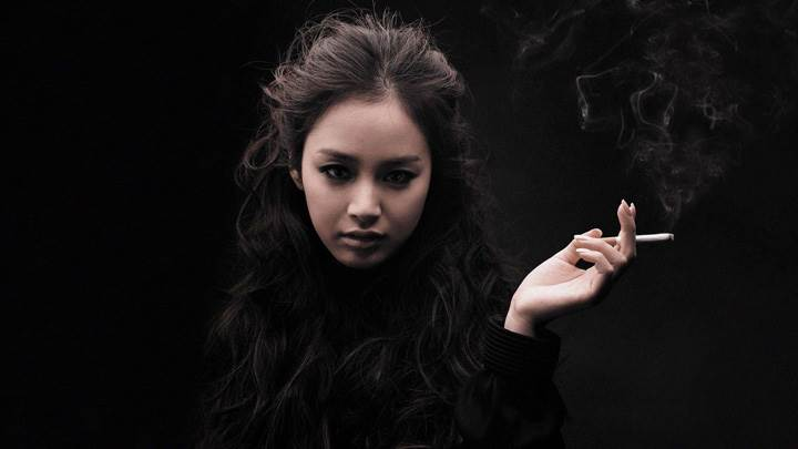 Girl Is Smoking In Black Dress