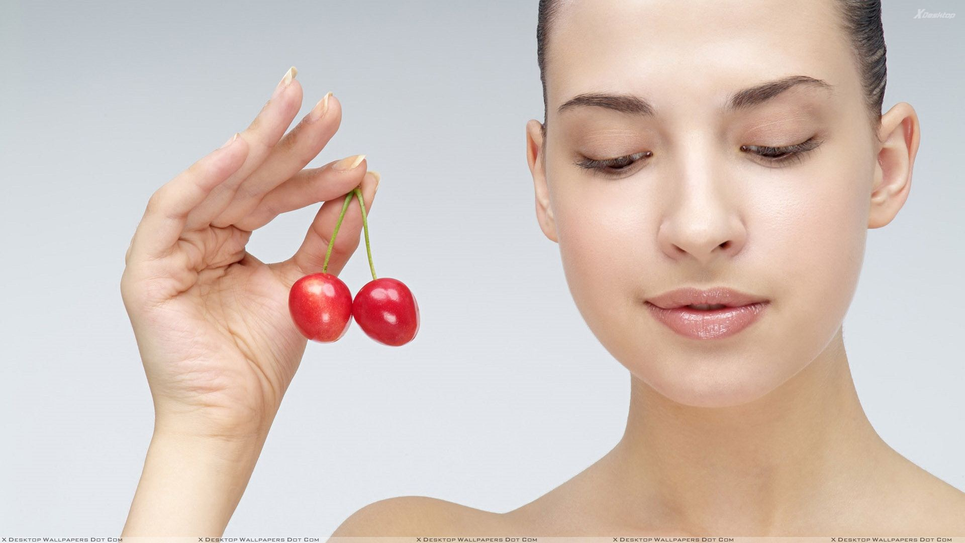 Girl Showing Red Cherry In Hand Photoshoot