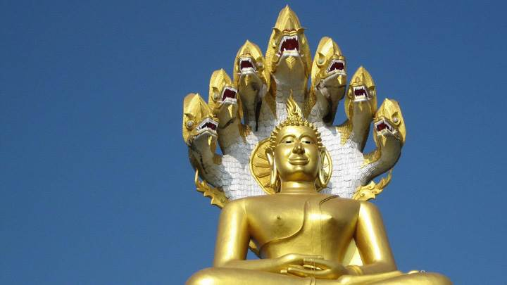 Golden Budha And Blue Background