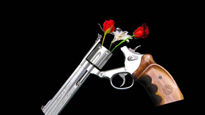 Guns And Roses On Black Background