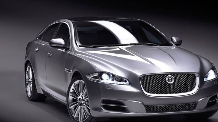 Jaguar XJ In Grey N Grey Background Front Pose